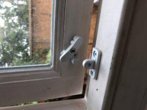 Catchment window swing lock